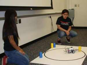 Campers working with the Lego robot.
