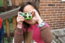 Girl using a camera to take pictures