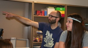 image of Cecelia Koshela and teacher Erik Pelttari discussing a math problem.