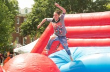 Student on inflatable game