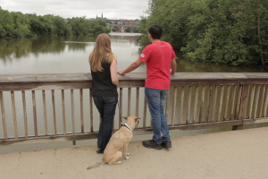 Ambuj Neupane and Katie Saunders on a walk with their dog