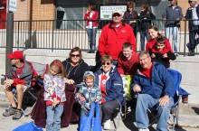 Young family at Homecoming parade