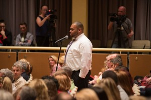 Image of a student asking President Larry Dietz a question about MAP grants during the 2015 State of the University Address.