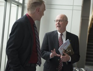 John Baur talks with WGLT General Manager Bruce Bergethon at the launch of the Redbird Scholar.