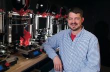 Rob Martin poses with 3-D printer