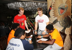 YouthBuild student and Illinois State teacher candidates collaborate on a scavenger hunt in the City Museum of St. Louis.