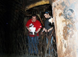YouthBuild student and Illinois State teacher candidate Kevin Goffard (left) collaborate on a scavenger hunt in the City Museum of St. Louis.