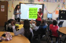 image of students from Illinois State's Languages, Literatures, and Cultures work with students from Unity Community Center.