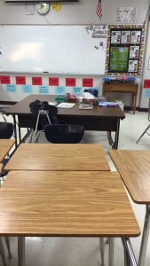 Middle level education major Nicole Carli snap a photo of the classroom where she is teaching sixth grade English Language Arts during her San Antonio student teaching placement.