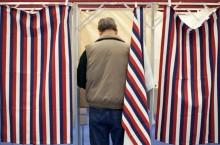 image of a man in a voting booth