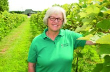 Mary (Mouser) Hofmann '76 in her vineyard in Carlock