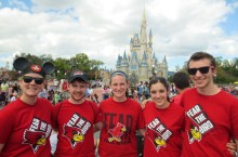 Students wearing their Fear the Bird shirts at Disney World.