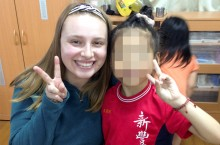 Jepsen scholarship recipient Kasey Ockerlund with a kindergarten Taiwanese student at a school the study abroad group visited in the summer of 2015.