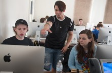 3 students look at a computer