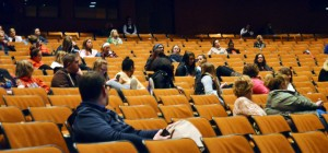 Attendees participate in an expert panel question and answer session at the screening of Paper Tigers.
