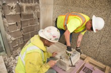 Workers remove time capsule from cornerstone
