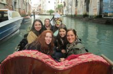 Lauren Vahldick on a boat in Venice with other students