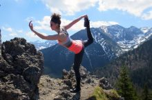 Michelle Grzybowski doing yoga move in the mountains