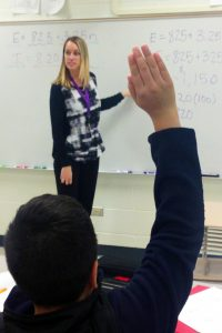 Lisa Browning '15 works on a math lesson with her students at Jack London Middle School in Wheeling.
