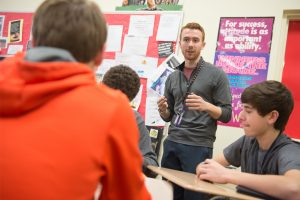 Blake Slutz works with his students