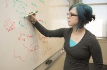 National Science Foundation Fellowship Samantha Norris writing at chalkboard