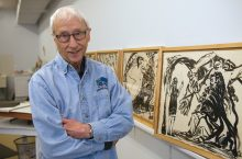 Harold Boyd next to artwork
