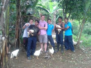 Conley with local youth in Costa Rica