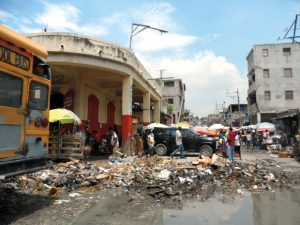 An area of stores and shops in downtown Port-au-Prince suffered such damage in the massive 2010 earthquake that rubble remained in the streets years later. Jamie Schumacher took this photo in 2013.