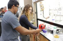 Students work in Professor Andrew Mitchell's Chemistry lab during the Summer Research Academy.
