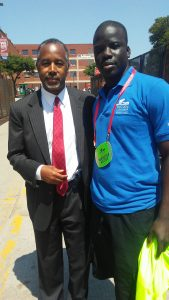Illinois State junior Youssoupha Mbodji with former presidential candidate Dr. Ben Carson at the GOP convention.