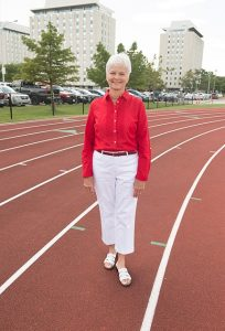 Joyce Morton Kief standing on a track