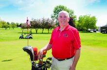 Professor Emeritus Larry Quane on the golf course