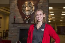 Beth Geistlinger poses inside Alumni Center
