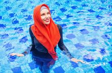 Image of a woman swimming in a burkini.