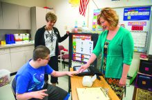 Kristi Probst with a student and a teacher