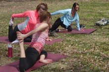 People doing yoga on the Quad
