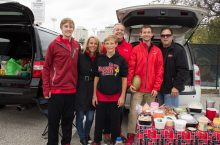 family smiling at tailgate