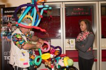 Student gets a balloon animal during the UPB Homecoming Carnival.