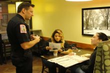 Students talk with Illinois State University Police Chief Aaron Woodruff during Coffee with a Cop.