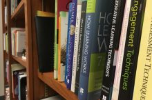 Books on Dr. Claire Lamonica's bookshelf