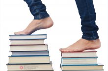 Bare feet on a pile of books