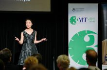 Student presents on the 3MT stage