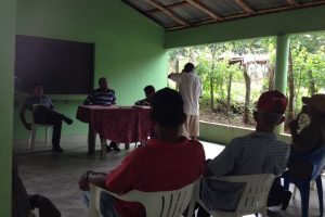 The Fruit Farmer's Cooperative discussing the aid process on obtaining machinery that removes pulp from mangoes.