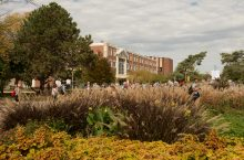 Students walking in front of Schroeder Hall on fall day.
