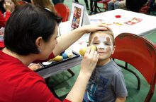 image of little boy getting face painted.