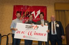 Startup Showcase winners pose with big check