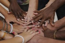Image of many hands together