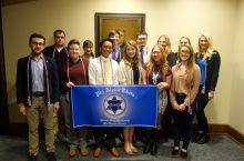 New inductees for Phi Alpha Theta for the fall semester with the PAT banner