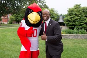 Levester Johnson with Reggie Redbird