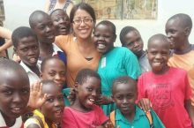 Campus recruiter Vanessa Soto as a Peace Corps volunteer in Uganda surrounded by children